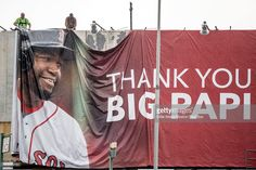 A new billboard for David Ortiz #34 of the Boston Red Sox is installed on Lansdowne Street above Fenway Park before a game between the Boston Red Sox and the Arizona Diamondbacks on August 12, 2016 at Fenway Park in Boston, Massachusetts. It was his second three run home run of the game.