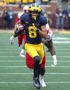 Michigan football WR Ronnie Bell has epic quarantine workout: Pushing a Chevy Tahoe College Football Season, Defensive Back, Detroit Free Press, Lamar Jackson, Wide Receiver, Michigan Wolverines, Stay In Shape, Lineup, Football Helmets