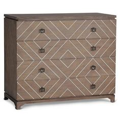 The classic oak chest of drawers gets a modern update with brilliant white bone inlay forming a geometric pattern across the four spacious drawers. The diagonal natural bone contrasts with the horizontal lines of the chest and the square antique bronze drawer pulls. The spacious storage is perfect in a bedroom, hallway or dining area. #kathykuohome