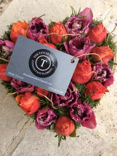 Tulips & Roses - purples & orangey reds offset with scented dark green rosemary for a striking colour palette
