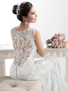 Maggie Sottero - MELANIE, Delicate corded lace on tulle skims the shoulders and neckline of this lightweight wedding dress with attached Monroe slip dress while buttons trail a zipper closure accenting a deep, illusion back.