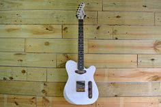 Here's the newest addition to our in-house design collection: a Dixie with a translucent white finish and walnut hardware.  Design your custom guitar at www.monikerguitars.com.