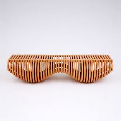 The organic shape of this bench / table / recliner is the result of clever mathematics. The rings are serial, concentric hoops, like the layers of an onion, cut from less than 3.4 m2 of flat furniture-grade plywood using CNC technology. The variations in diameter of the rings create a structurally stable, undulating sequence.
