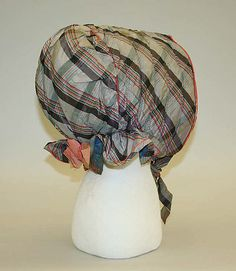 Bonnet    Date:      1840s–50s  Culture:      American  Medium:      silk, cotton  Dimensions:      Length (from CF to CB): 18 3/4 in. (47.6 cm)  Credit Line:      Gift of Marjorie Park Swope, 1988  Accession Number:      1988.110.1  MET