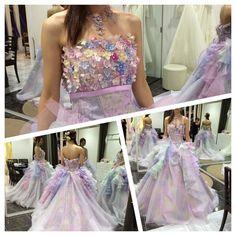 . #ドレス試着 レポ #カラードレス 11 . #神田うの さんの#新作ドレス だそうです . 胸元の小花は取り外し可能 腰からのカラフルなフリルも大きめなキラキラグリッターも素敵でした . 好きな色だけど淡い色は私には合わないかなもう少し濃かったりぱきっとした色じゃないと写真映えしないのかな . 実物はすごく鮮やかなんですがこうやって写真に撮るとちょっと暗く見えるかな 本番の写真写りのことも考えるともうちょっと色濃い方がいいのかななんて考えてみたり . けど可愛いですね紫陽花虹色な感じが6月挙式にはぴったりなイメージ . わたし的にウエディングドレスはマーメイド系で#カクテルドレス はふわふわ系がいいかなあと思っております . #プレ花嫁 #結婚式 #結婚式準備 by mgmwed