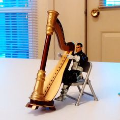 The Punisher: My Gun, My Harp, and Me - Punisher from The marvel Universe Collection can sit and play the harp after all.