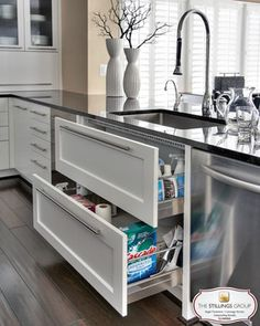 These drawers are designed around the sink basin to offer more convenient under-sink storage space.
