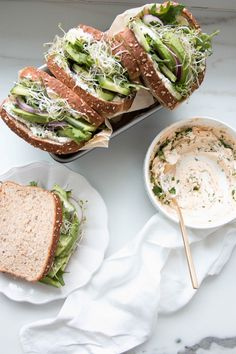 """Eat Your Greens"" Sandwich with cucumber, avocado, cream cheese and sprouts."