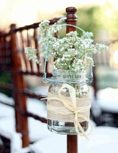 Got a lot of mason jars that you don't need? Guys, I've found so many creative ways to use them for your wedding decor! Mason jars are ideal as centerpieces – just add some water, flowers and stones on the bottom!