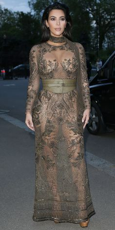 Kim Kardashian Dons a Sheer Dress Ahead of 2nd Anniversary with Kanye West in London from InStyle.com