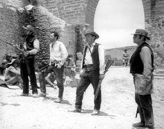 THE WILD BUNCH (1969) - Ben Johnson, Warren Oates, William Holden & Ernest Borgnine confront the enemy - Directed by Sam Peckinpah - Warner Bros. - Movie Still.