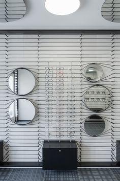 Optical glasses interior design cerca con google for Espejo hostelero