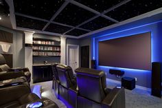 South Austin Home Theater by Zuri Custom Homes & Renovations - Awesome Glow Effect Theater and Seating