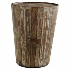 "Handcrafted reclaimed wood side table with a distressed finish.  Product: Side tableConstruction Material: Reclaimed woodColor: Lime washFeatures: HandcraftedDimensions: 24"" H x 19"" DiameterCleaning and Care: Please do not use harsh chemicals"