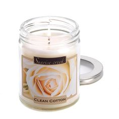 """Clean Cotton Scent Candle -The aroma of crisp cotton adds open-air freshness to any room! Simply set this candle aglow to savor its uniquely uplifting fragrance that banishes musty odors and brings to mind a sunny summer day. Burns up to 45 hours.7.3 oz. Made in USA. Weight 0.8 lb. 2 7/8"""" diameter x 3 1/2"""" high. sSoy blend wax with lidded glass jar."""
