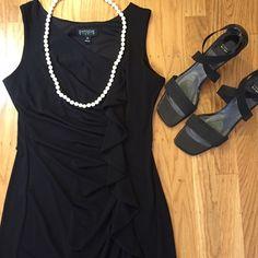 "Stunning black dress. Enfocus Studio black dress with a little stretch.  38"" long. 16"" under arm to under arm. Good condition. Dresses Midi"