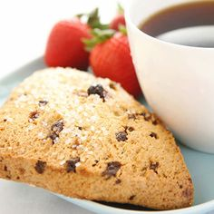 Chocolate chip scone, strawberries, and coffee. Breakfast of champions.