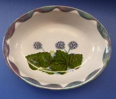 This is a beautiful large Scottish Highland Stoneware Oval Serving Bowl   - decorated all over with a stunning hand painted design called WILD BERRIES. It shows a selection of Scottish wild berries and fruits - a really stunning piece for your dining table.  This is a substantial and collectable piece of pottery.  Dimensions: 22.5 cm in length; 20 cm wide and 7 cm in depth.  This is one of two in my store - but all pieces are slightly different due to being hand painted - so have listed this…