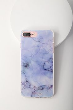Protect your device all while displaying a cute design with The Casery Blue Marble iPhone 6/6s Plus, 7 Plus, and 8 Plus Case! This clear plastic case has a marble print in shades of blue, flexible bumper edge, raised front (for extra screen protection), and access to all ports. Fits iPhone 6/6s Plus, 7 Plus, and 8 Plus.