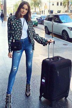 Olivia Culpo wearing 3x1 W3 High Rise Skinny Jeans in Cypress, Jimmy Choo Marlin Boots and Chanel Mini Flap Bag