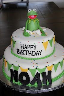 Kermit the Frog Cake. I am thinking this cake with pink icing and green/purple flag for Juliets bday cake. I need to find a Kermit and Miss Piggy figurine for top