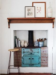 turquoise stove -- what a cute little way to make use of a tiny space.