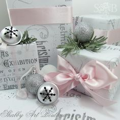 pink ribbons with silver bells...