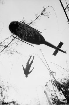 Henri Huet / AP. The body of a U.S. paratrooper killed in action in the jungle near the Cambodian border is lifted up to an evacuation helicopter in War Zone C, May 14, 1966. The zone, encompassing the city of Tay Ninh and the surrounding area north of Saigon, was the site of the Viet Cong's headquarters in South Vietnam.