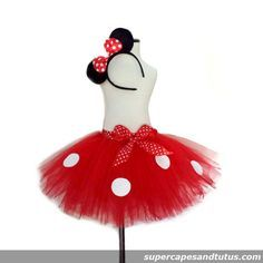 Minnie Mouse Inspired Tutu Skirt with Ears  This Minnie Mouse Inspired Tutu is made with red tulle for the bottom and a matching polka dot bow.  Simply elegant