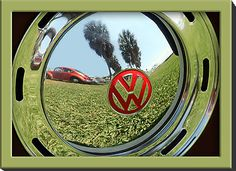 Reflection in the hub of a classic V W bug.
