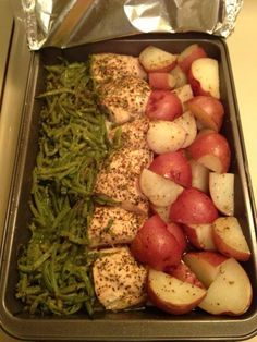 In a 9x13 pan, cut 3 chicken breasts in half, add 2 cans green beans on one side and cut up red skin potatoes on the other. Sprinkle a packet of zesty Italian dressing mix over the top. Drizzle a stick of melted butter over it. Cover it with aluminum foil and bake at 350 for 1 hour.