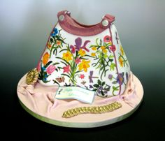 Painted Purse - This birthday cake is hand-painted using the cocoa butter method. The cake board is decorated in fondant, and edible inscription, and gumpaste jewels.