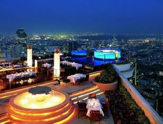 "Sirocco is the world's largest all open-air restaurant and ""Sky Bar"", located on the floor of the State Tower in Bangkok, Thailand, which is the. Sky Bar Bangkok, Bangkok Hotel, Bangkok Thailand, Bangkok Travel, Thailand Travel, Thailand Honeymoon, Hotels And Resorts, Best Hotels, Luxury Hotels"
