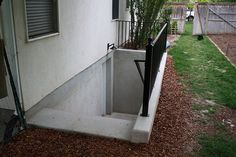 Basement Walkout, Flush With House, Beside Driveway
