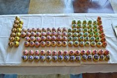 The Periodic Table Of Cupcakes (this would be very cool with cake truffles for a birthday party for a geeky husband. Not that I have one of those.)