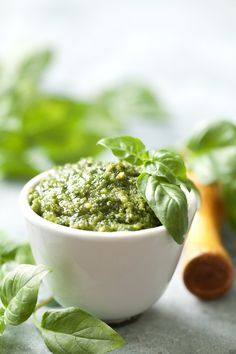 Walnut-Basil Pesto. 1 c fresh basil leaves, 2 cloves garlic, 2-3 T walnuts, 1/3 c parmesan cheese, 1/3 c olive oil, Salt and pepper to taste. Roast walnuts in pan on medium; set aside to cool down.  Add basil leaves & garlic to food processor.  Add parmesan, walnuts, spices, and olive oil. Process to desired consistency.