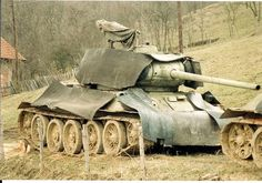 army A Bosnian Serbs Army T-34-85 with added rubber plates as additional armor near Doboj, spring 1996