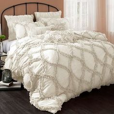 """Ivory-hued comforter set with a ruffled design.  Product: Queen: 1 Comforter and 2 standard shamsKing: 1 Comforter and 2 king shamsConstruction Material: PolyesterColor: IvoryDimensions: Queen Comforter: 92"""" x 96""""  King Comforter: 96"""" x 110""""   Cleaning and Care: Dry clean"""