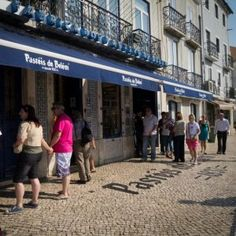 Queues outside this long established bakery in Belem Portugal. Check out our detailed city guide! Belem Portugal, Custard Tart, Coffee Shops, Lisbon, Bakery, City, Check, Coffee Shop Business, Cream Pie