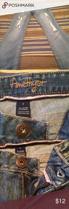 Jeans Size 7 amethyst jeans regular has detreesed look. Has lil spots on bottom of one leg but purchased that way at belk. Used good condition. Smoker amethyst Jeans Flare & Wide Leg