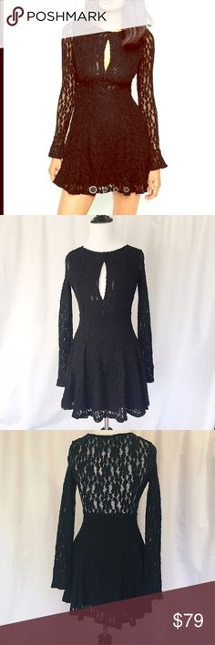 """Free People // Lacey Fit and Flare Dress NWT! Black lace fit and flare dress with adjustable keyhole neckline. Long sleeves with flared cuffs. Hidden zipper on side. Double hook-and-eye closure at bust. There is a small snag near zipper that is shown in last photo, but it's barely noticeable. Front of dress and skirt are fully lined. Measures about 15"""" across chest, 29"""" in length from shoulder to hem. 97% nylon, 3% spandex. 🚫trades🚫 smoke free home Free People Dresses Long Sleeve"""