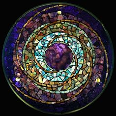 Plum Planet Stained Art Glass mandala Created from hundreds of pieces of stained glass and accented with fused glass jewels, This mosaic mandala is meant to be hung in a window.