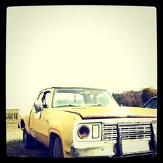 battered yellow pickup truck