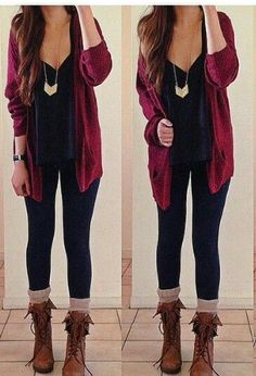 Burgundy knit cardigan, a gold necklace, a black v-neck t-shirt, dark wash skinny jeans, ivory knit socks, and tan combat boots.