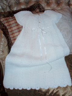 I have made many of these gowns for baby's baptisms. It is from an old Leisure Arts leaflet # 460, titled Baby Layettes. It is a very easy crochet pattern to follow and to make.  Honest.