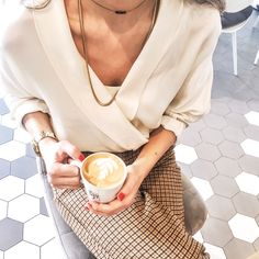 Cream blouse with tartan pants, coffee and red nails