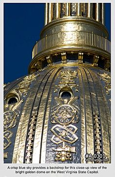 A close-up view of the bright golden dome on the West Virginia State Capitol.
