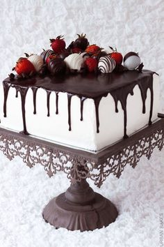 Square chocolate drip cake with chocolate covered strawberries