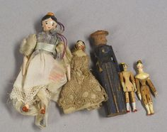 Five Tiny Early Wooden Dolls, Germany, 19th century, four peg wooden dolls, two…