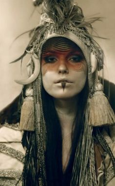 This woman's face is covered in paint and markings, much like a tribal warrior would. Fashion Fotografie, Mystique, Warrior Princess, Poses, Post Apocalyptic, Apocalyptic Fashion, Tribal Fusion, Headdress, Character Inspiration